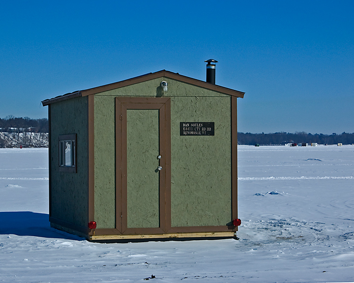 ice fishing shacks of lake menomin philip schwarz